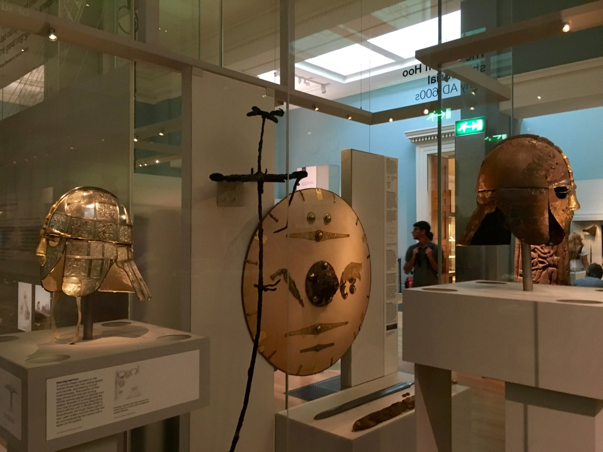 Display case with helmets and shield