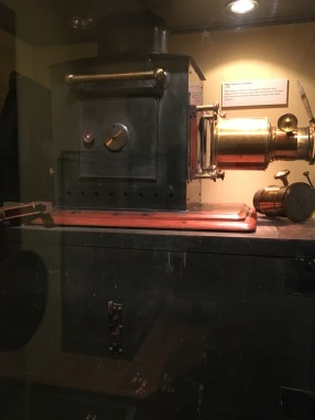 A slide projector on its case
