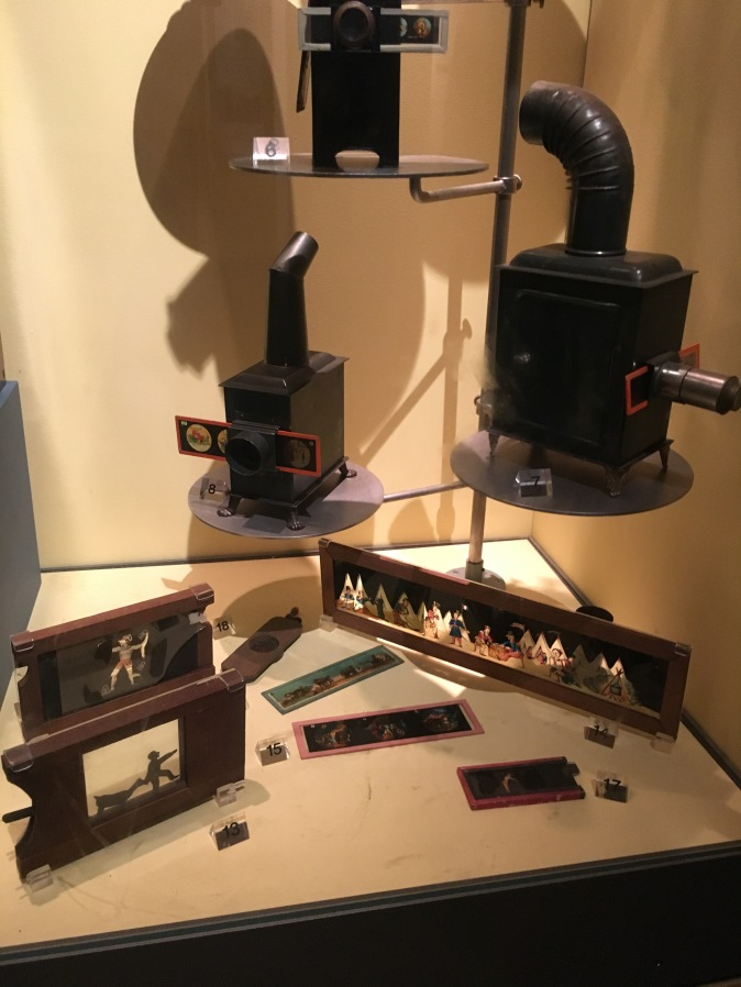 A display of slide mounts, slides and projectors