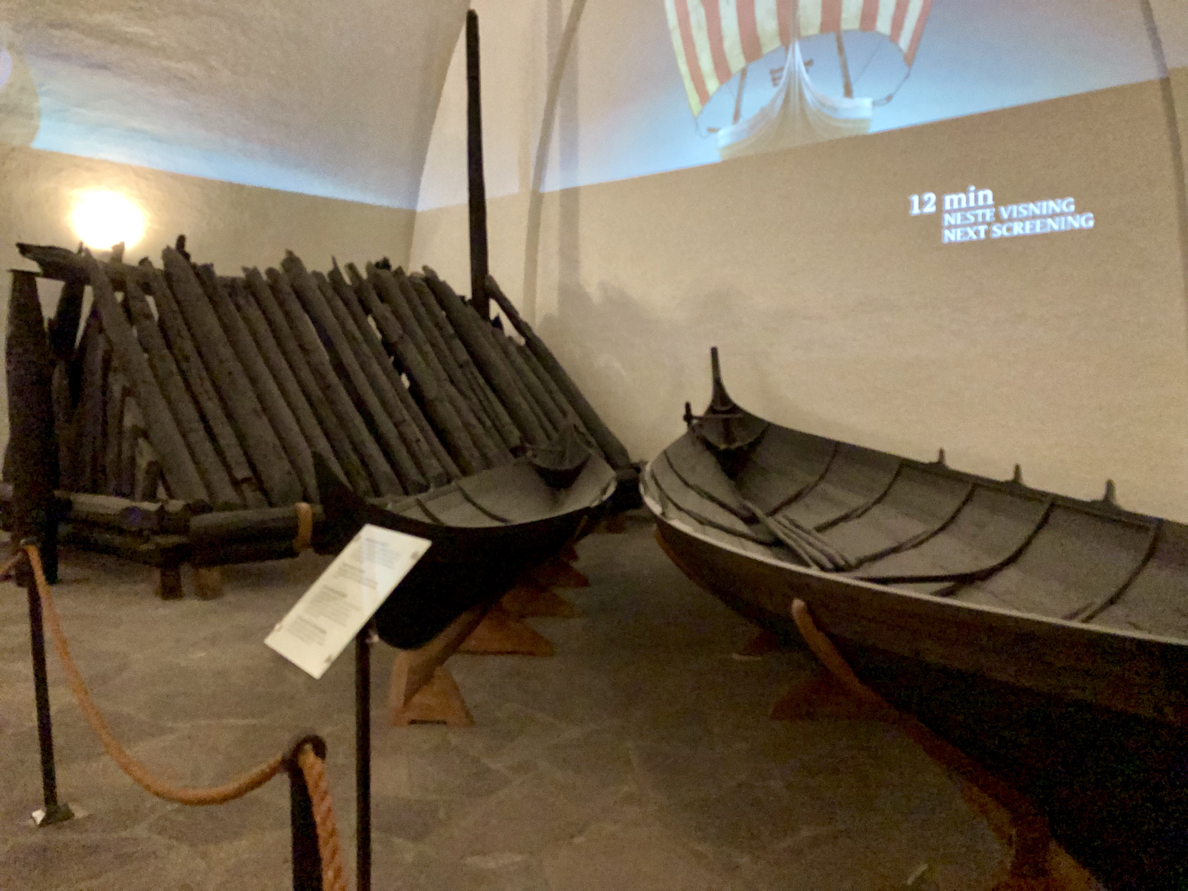 Photo of the Gokstad ship burial chamber and small boat